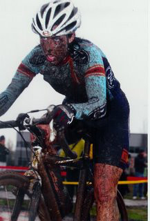 Kathy on a muddy day of cyclo-cross.