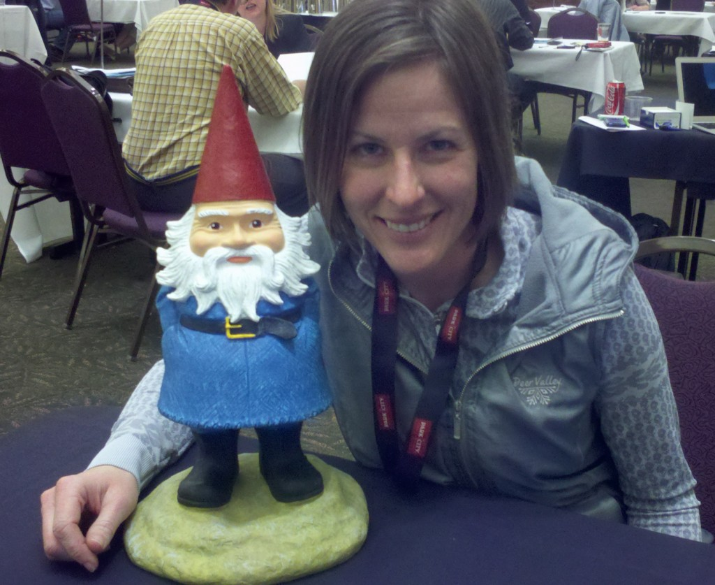 Kathy sharing trade secrets with the Travelocity Gnome.