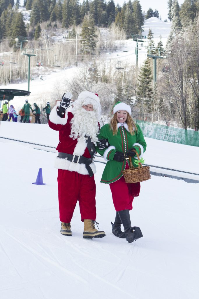 Santa visits Deer Valley Resort on Christmas Eve Day. Snow Park area.