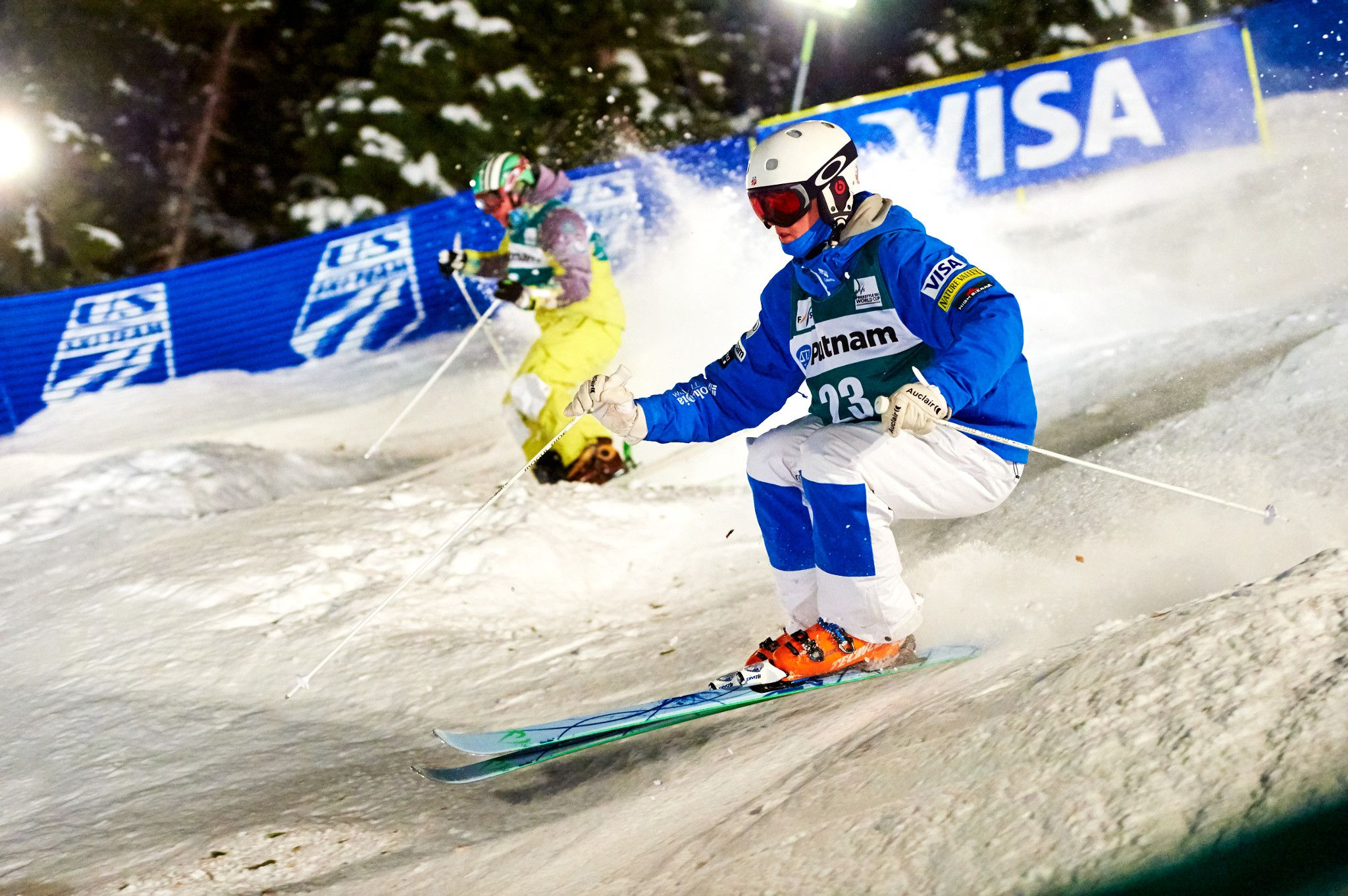 Two mogul skiers racing down Champion Ski Run at Deer Valley Resort during the 2018 world cup