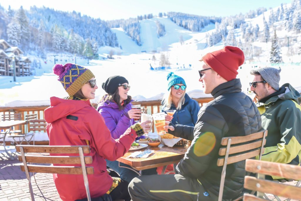 Guests enjoying a drink on the Snow Park Deck at Deer Valley Resort