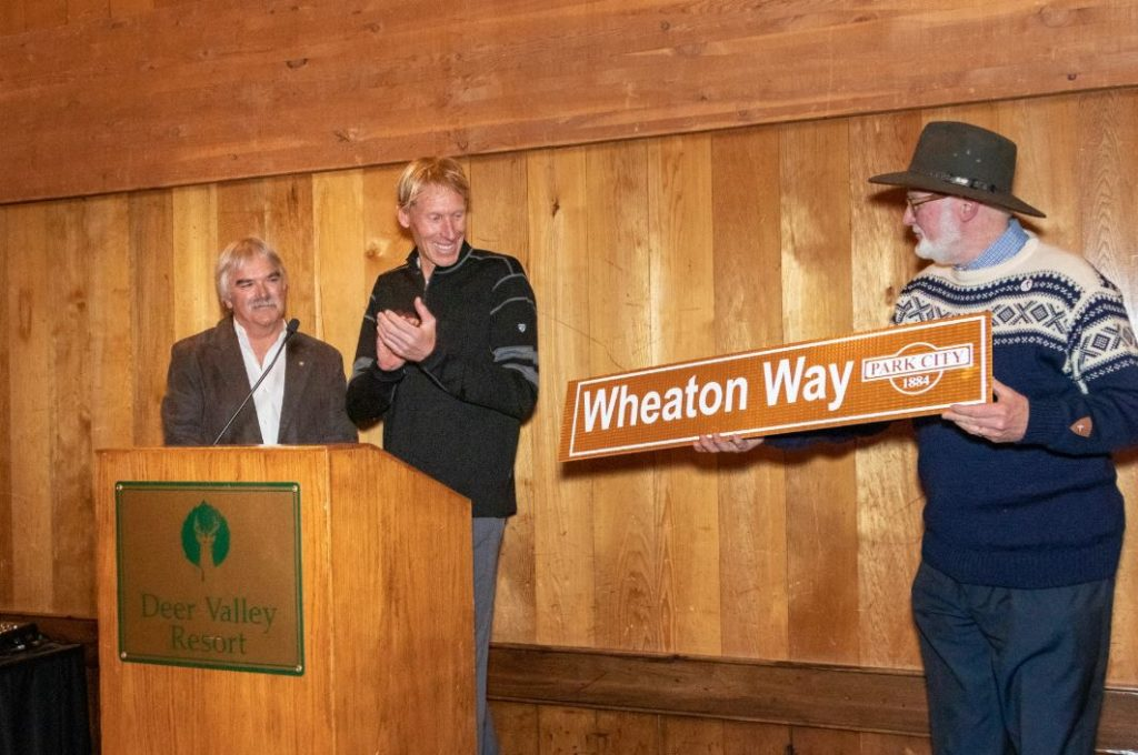 Bob Wheaton accepts the road sign to Wheaton Way.