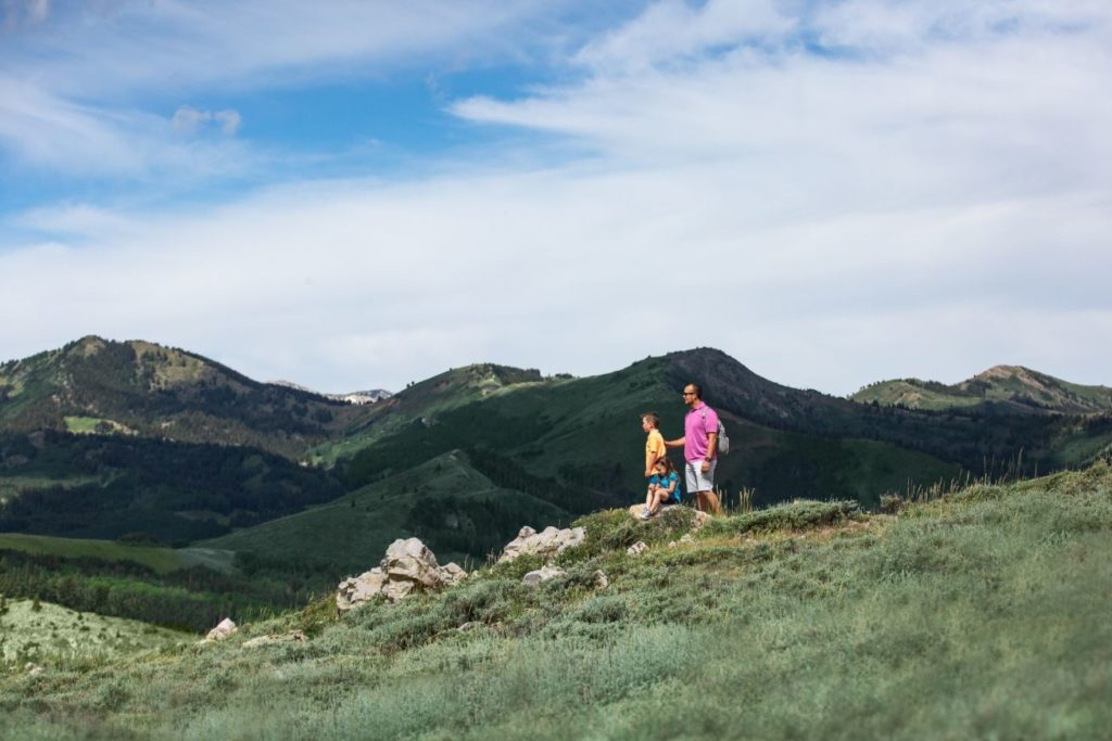 Three people hiking at Deer Valley in Park City, Utah.
