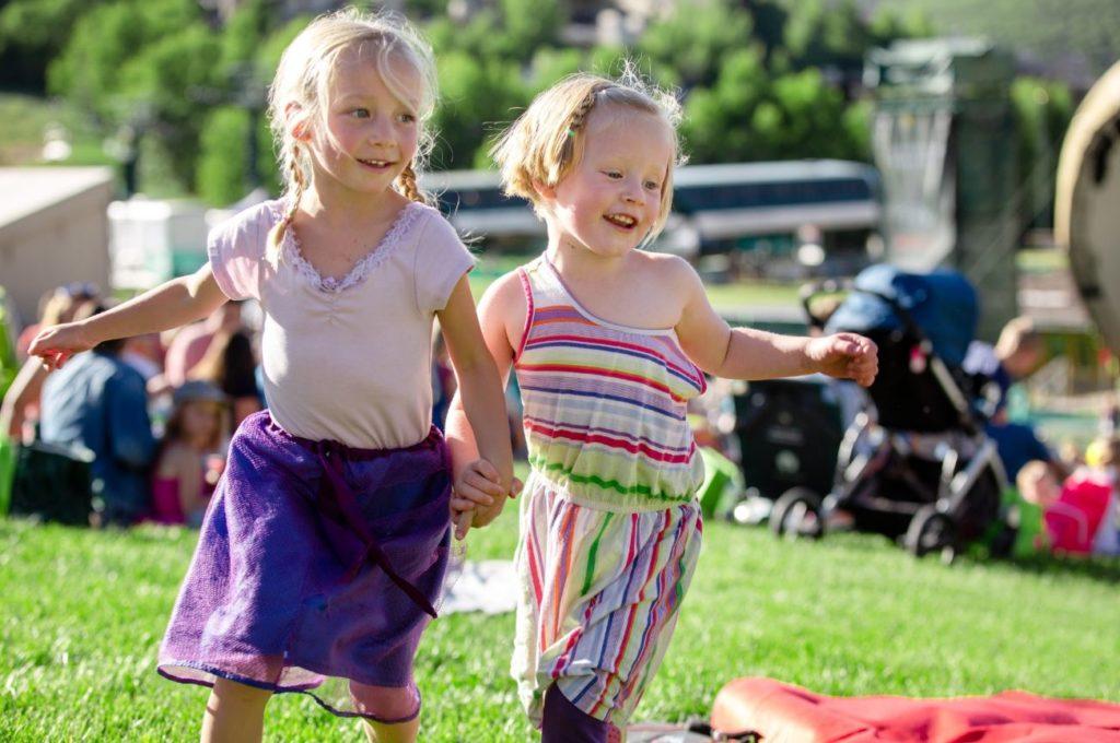 Two little girls at a concert at Deer Valley Resort in Park City Utah.