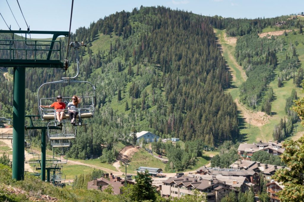 Two people on a summer scenic chairlift ride at Deer Valley Resort in Park City, Utah.