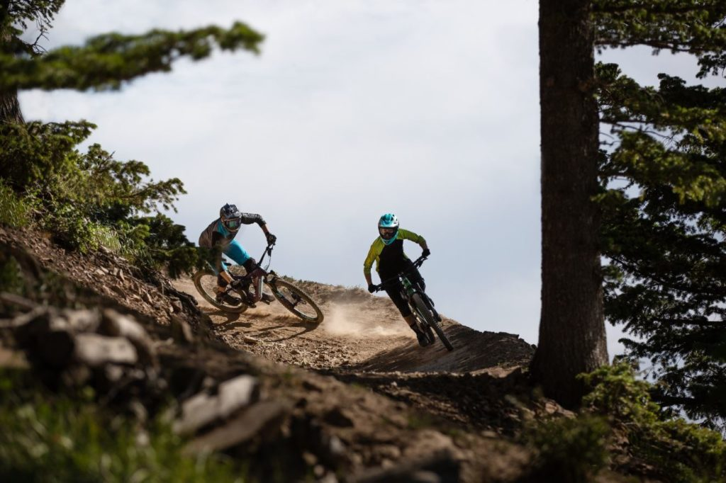Two mountain bikers in a berm