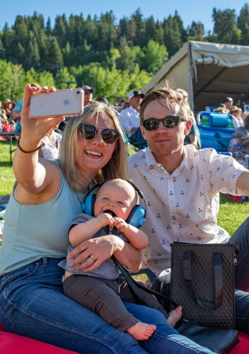 Family taking a selfie at a Free concert in Park City Utah.