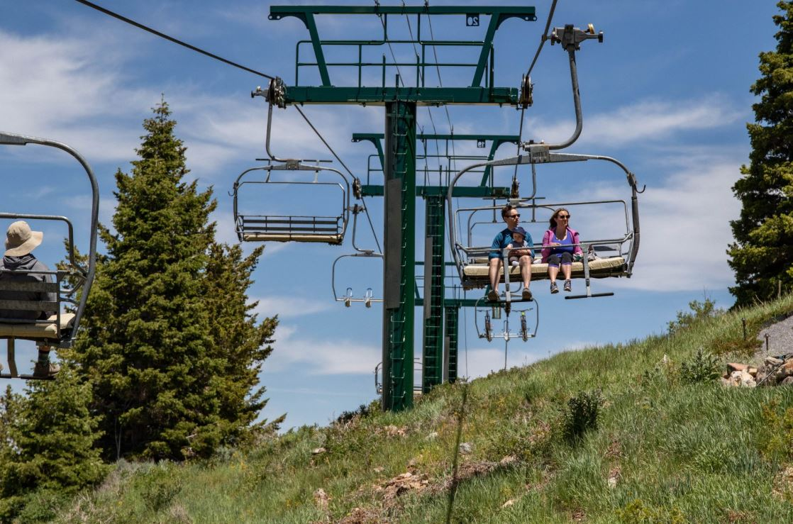 Family on a scenic chairlift ride at Deer Valley in Park City Utah.