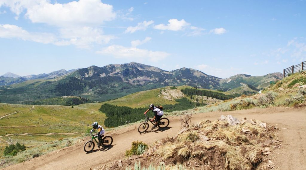 Two Mountain Bikers riding Holy Roller at Deer Valley Resort