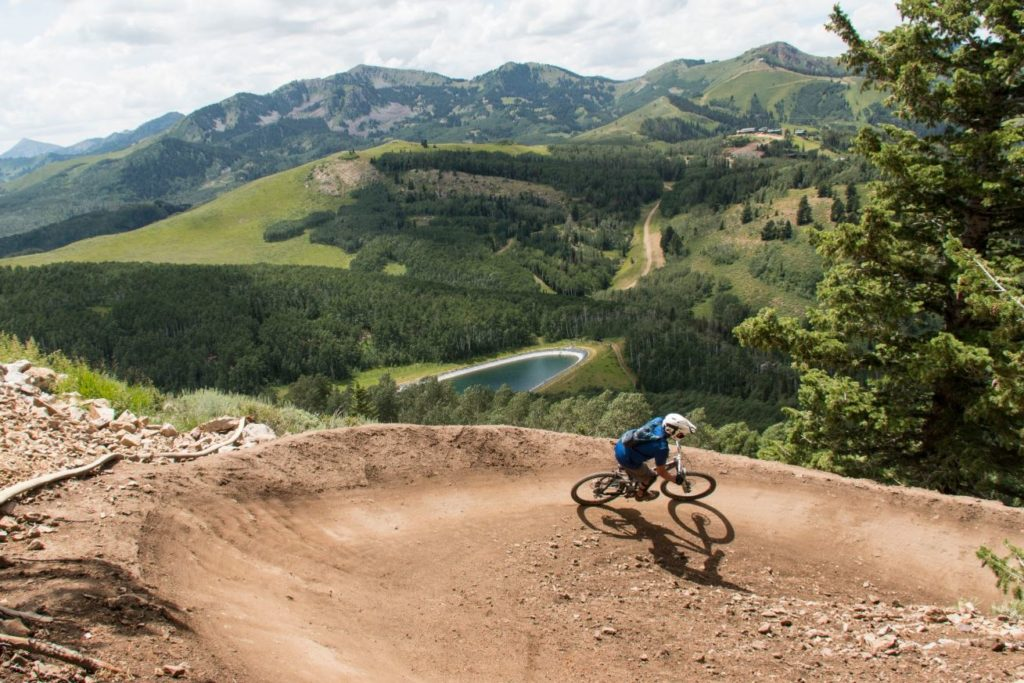 Mountain Biker riding Tidal Wave trail in Park City, Utah at Deer Valley
