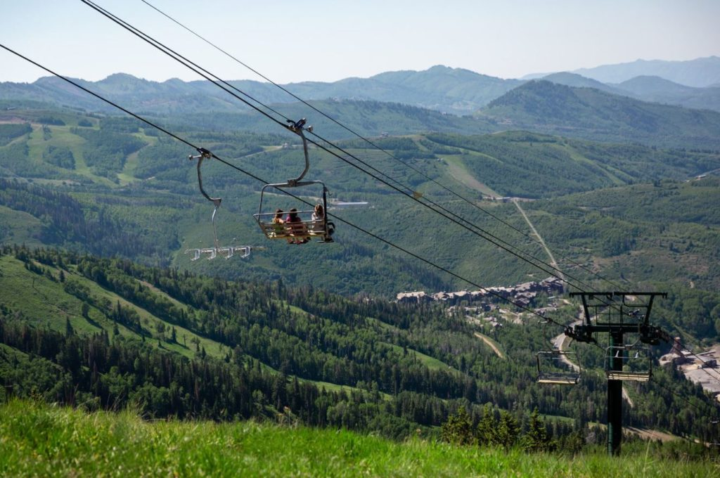 A group of friends taking a scenic chairlift ride at Deer Valley in Park City, Utah.