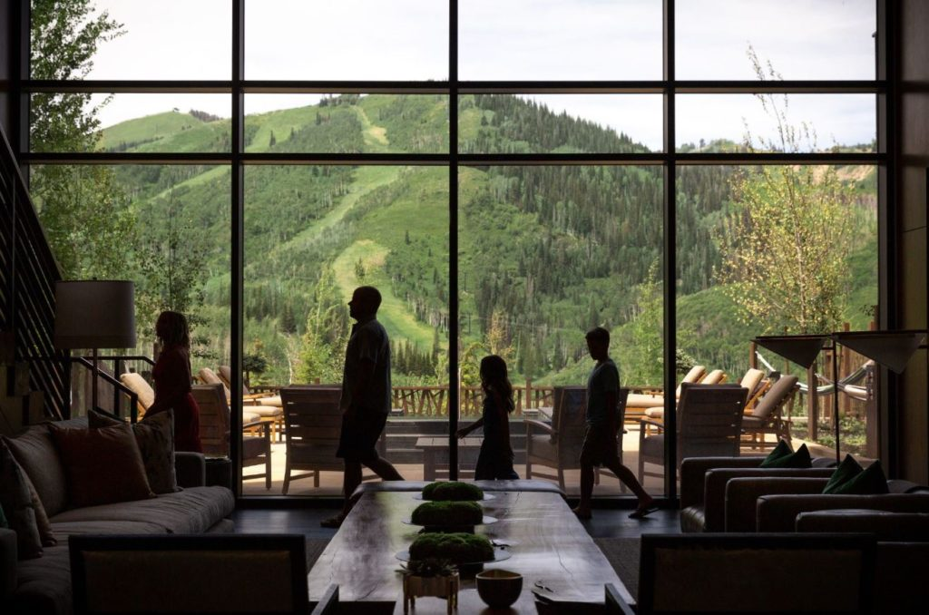 A family in front of a window with an amazing view of the mountains