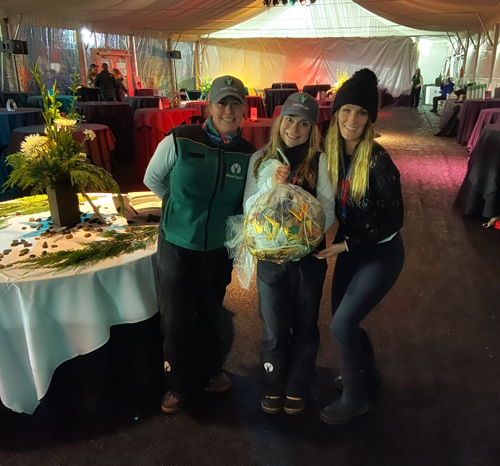 Julie Schultz, Madelyn Carter, and Heather Currie with the only bag of garbage that was produced from the VIP Tent at the event on Thursday Night.