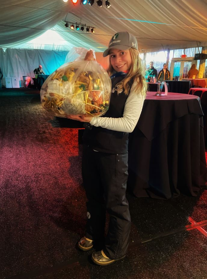 Madelyn Carter holding all of the garbage produced by the VIP Tent from the event on Thursday night.