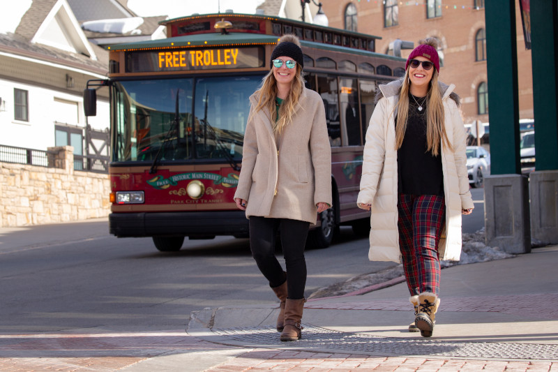 two females walking down Main Street in Park City, Utah.