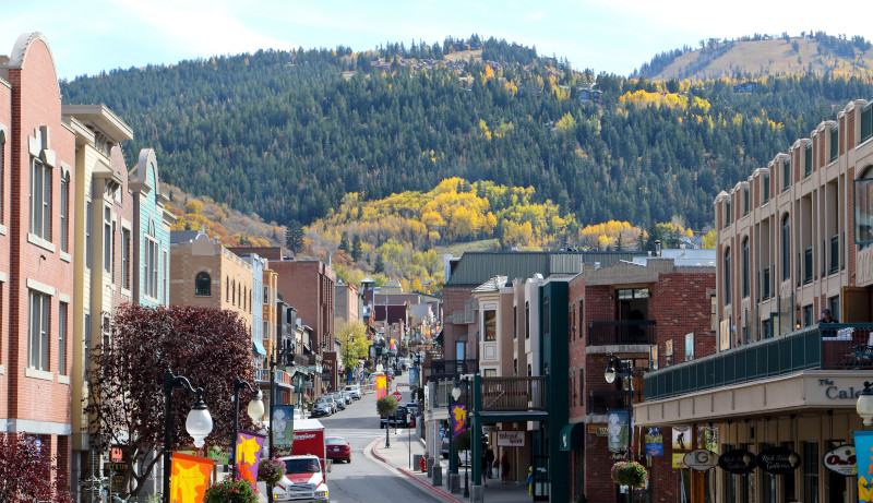 Main Street Park City with Deer Valley and fall colors in the background